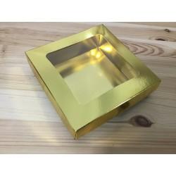 Caixa dourada com janela...